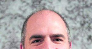 William J. Behre, 52